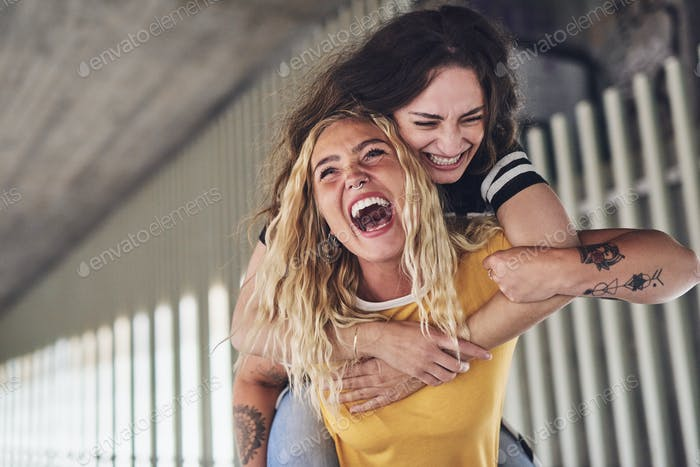 Best friends laughing and having a fun night out together
