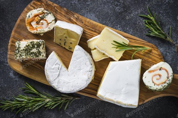 Cheese platter on dark stone table