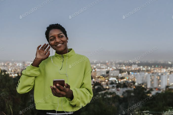 Woman listening to music from a phone