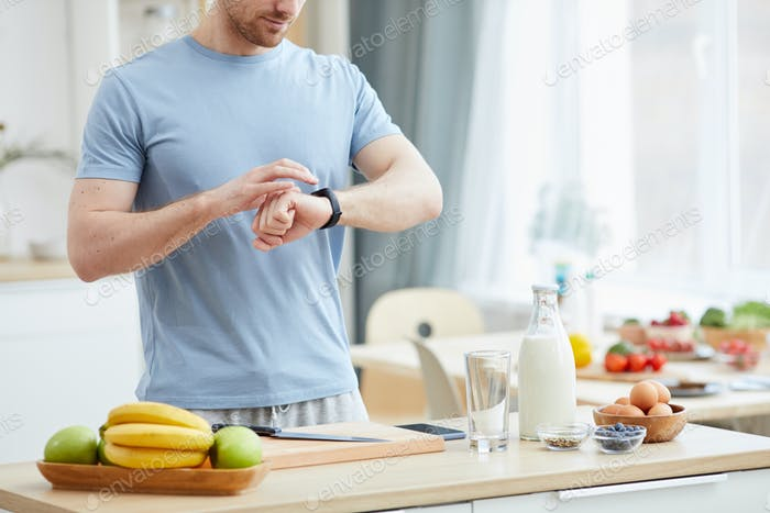 Man eating breakfast by the hour