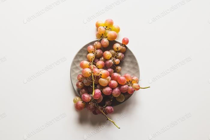 Isolated grapes. Red grape in a bowl isolated on white background