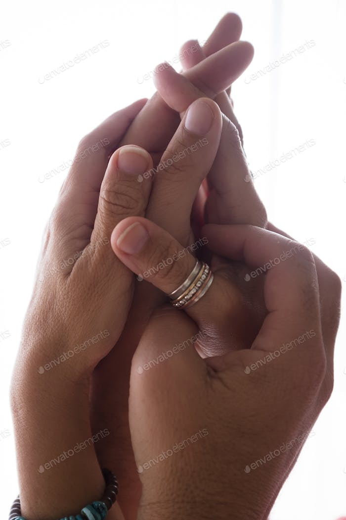 Love and passion relationship concept image with couple of man and woman hands holding