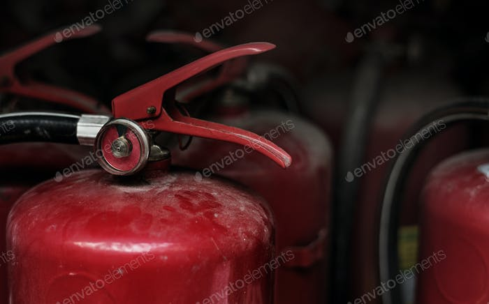 Closeup of red fire extinguishers
