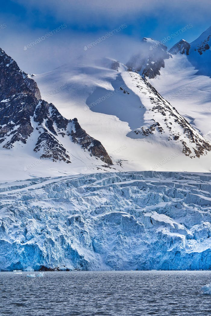 Deep Blue Glacier and Snowcapped Mountains, Arctic, Norway