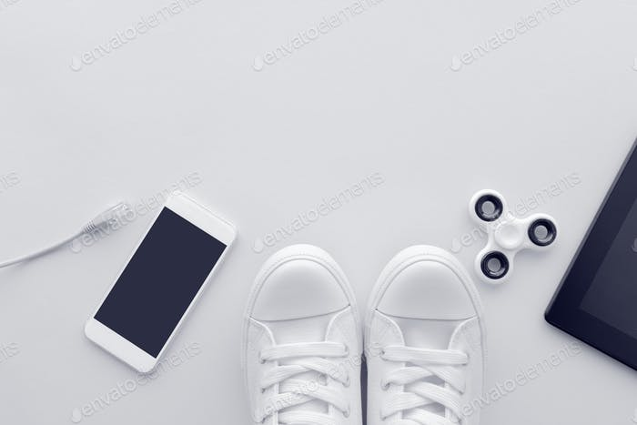 Millennial generation gadgets flat lay top view with copy space