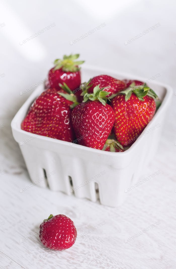 Fresh ripe strawberries on a vintage wooden background