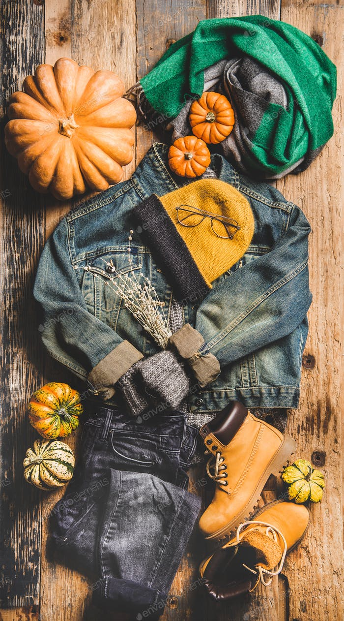 Autumn trendy women outfit layout over wooden background, top view