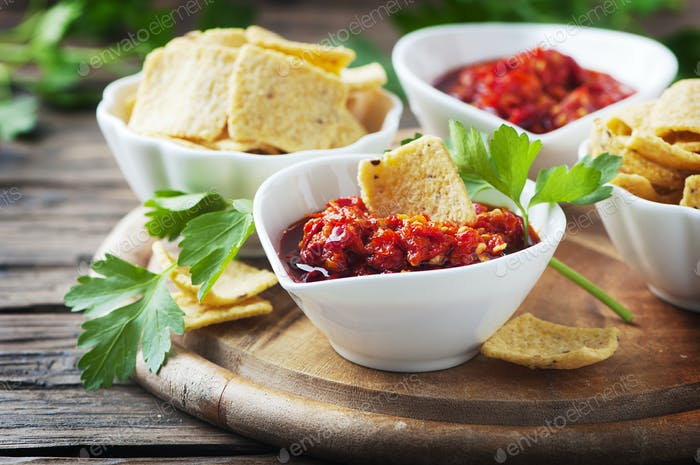 Hot mexican salsa with chili peppers