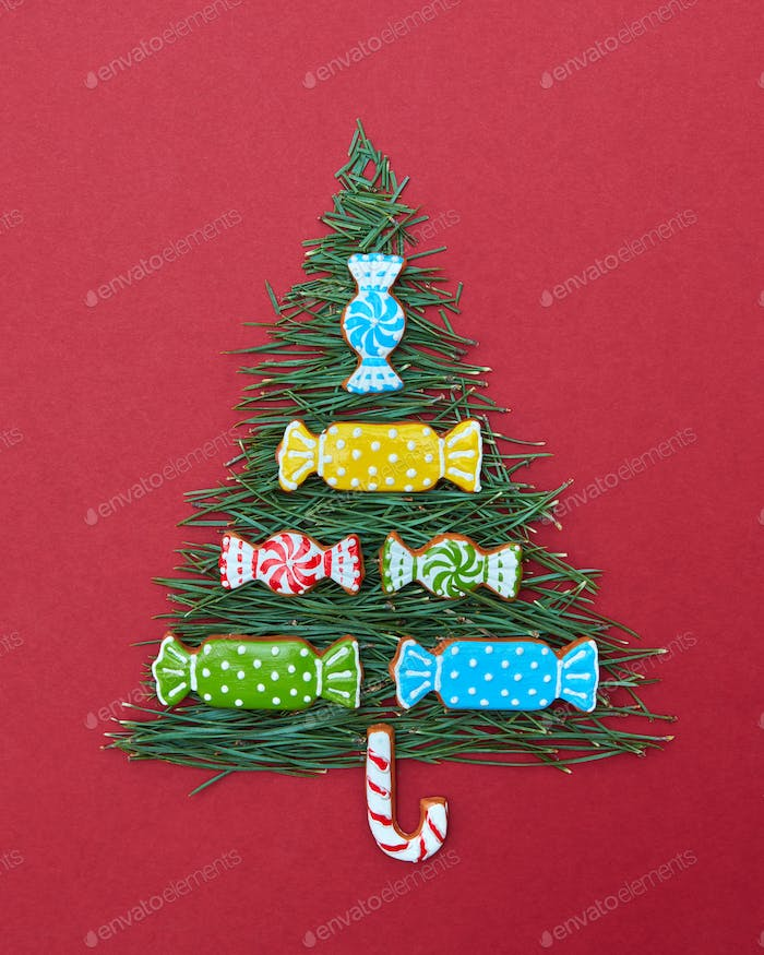 Christmas card with fir-tree needles and sweets of  cookies