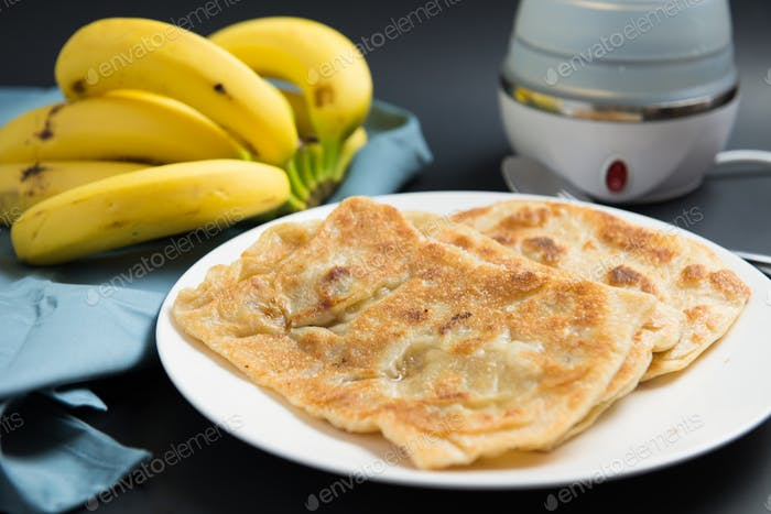 Indian breakfast banana paratha or pancake