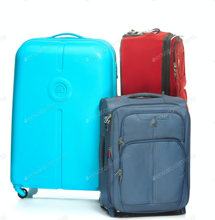 The modern suitcases on white background