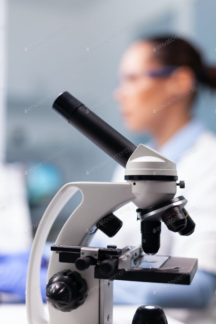 Selective focus on medical microscope standing on table in pharmacology microbiologist hospital
