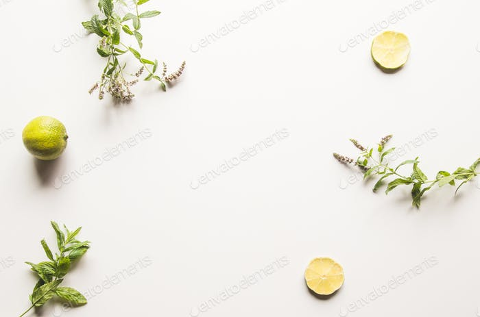Limes, fresh mint on white background. Top view