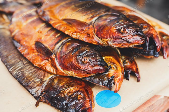 Seafood, trout fish grilled at barbecue