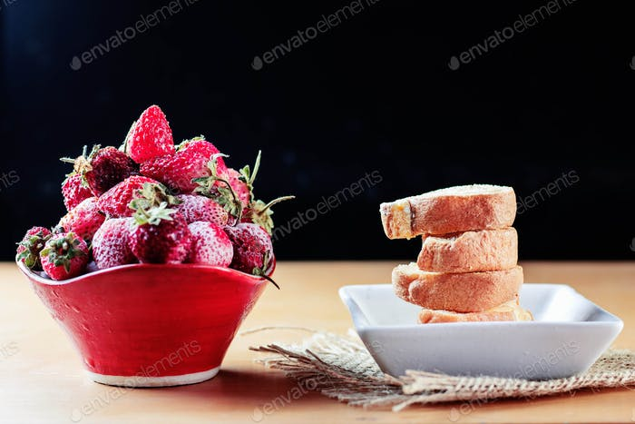Strawberry and cake on table