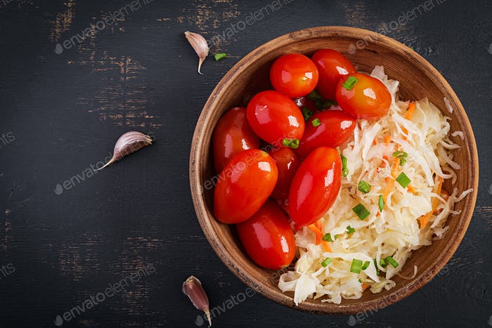 Marinated, sauerkraut with pickled tomatoes and onions. Top view