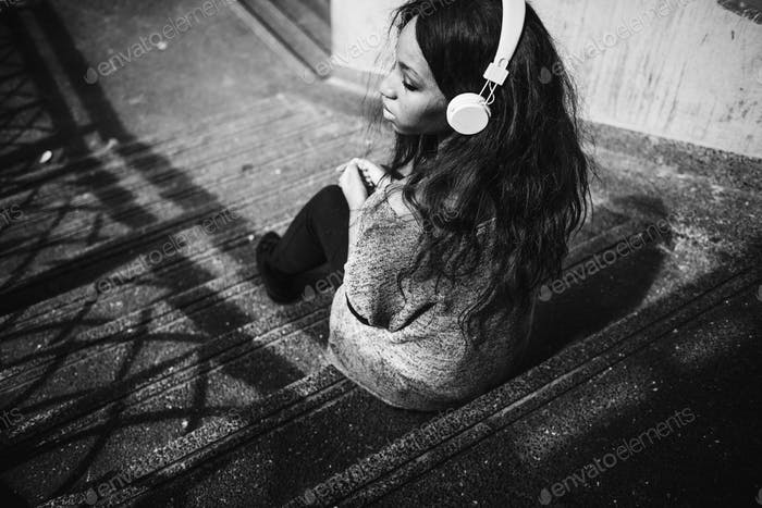 African American woman is listening to music photo by Rawpixel on