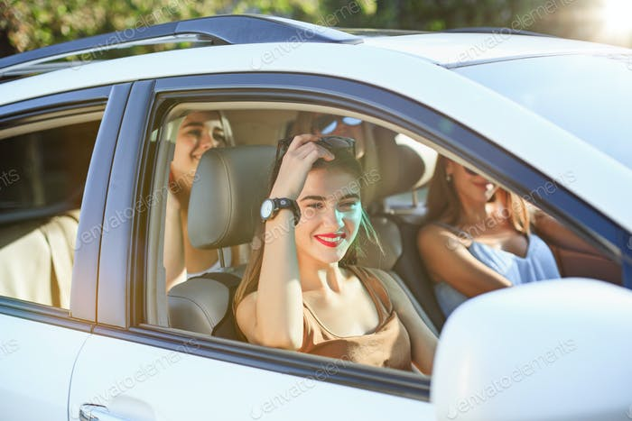 The young women in the car smiling