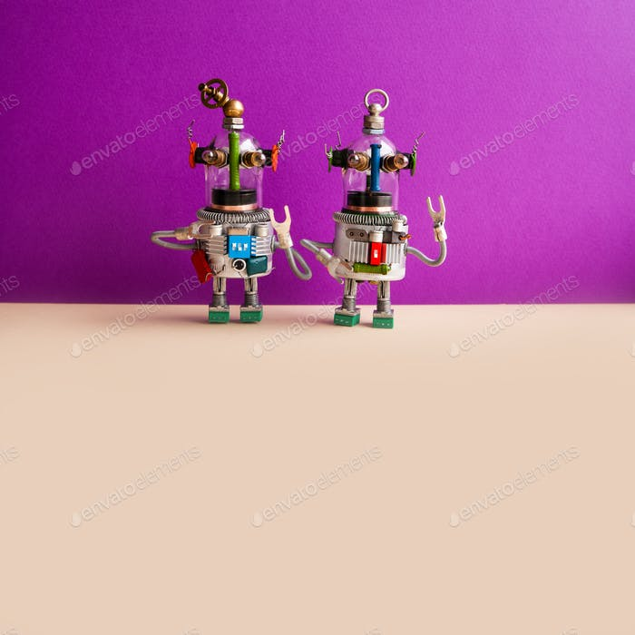 Funny ufo toys on purple wall background.