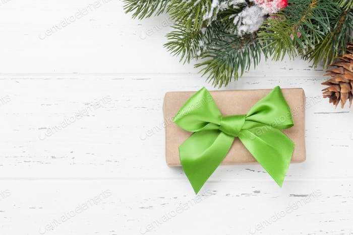 Christmas card with gift box and fir tree branch