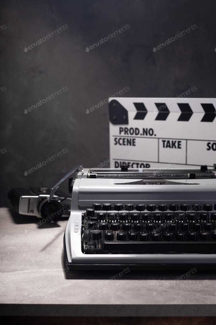 vintage typewriter, camera and movie clapper board