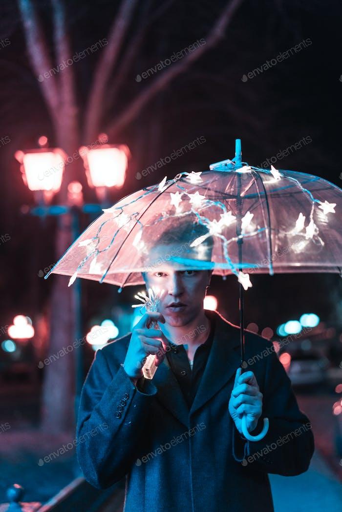 Guy under an umbrella