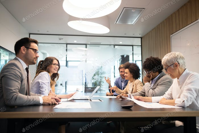 Business colleagues in conference meeting room presentation