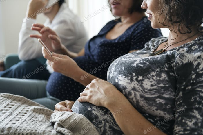 Pregnant support group meetup in a house