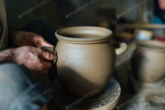 The man make pot from clay