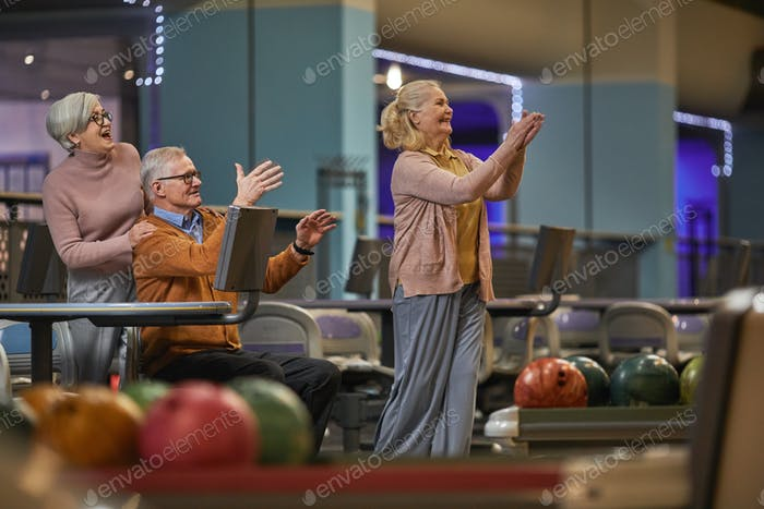 Joyful Senior People Playing Bowling