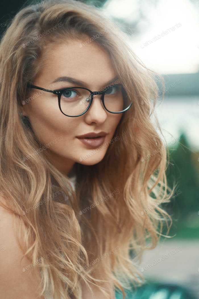 Fashionable eyewear model close-up portrait wearing transparent