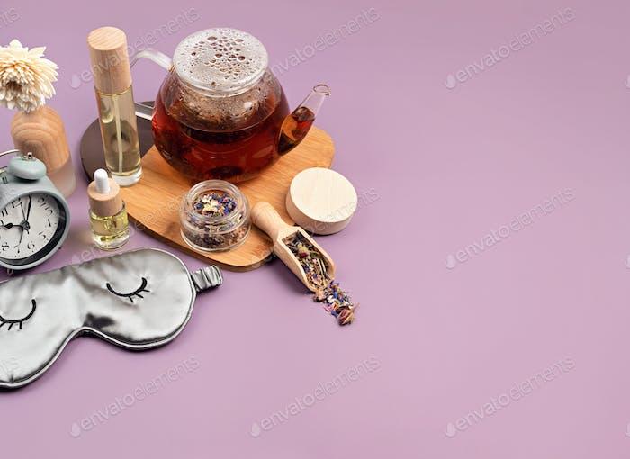 alarm clock, sleeping mask and herbal tea,concept of rest, quality of sleep .