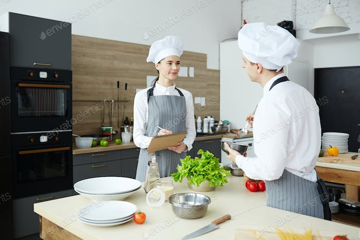 Quality expert examining commercial kitchen