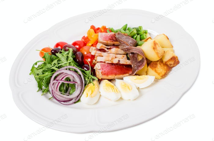 Delicious nicoise salad with baked potatoes.