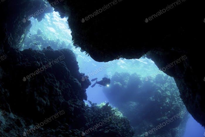 Scuba diver exploring underwater caves