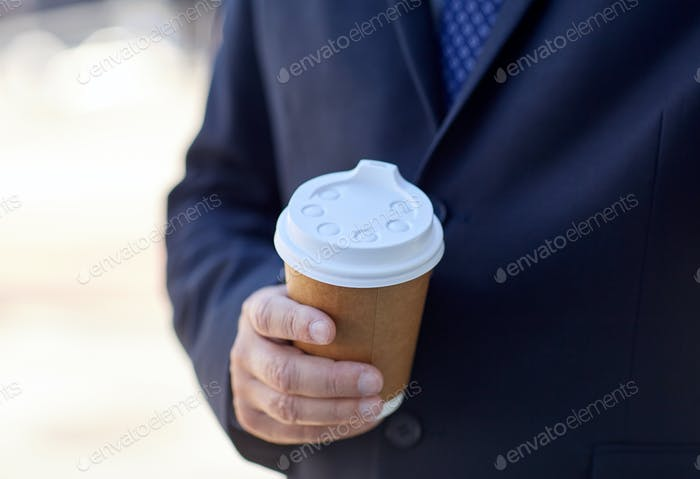 senior businessman with coffee cup outdoors
