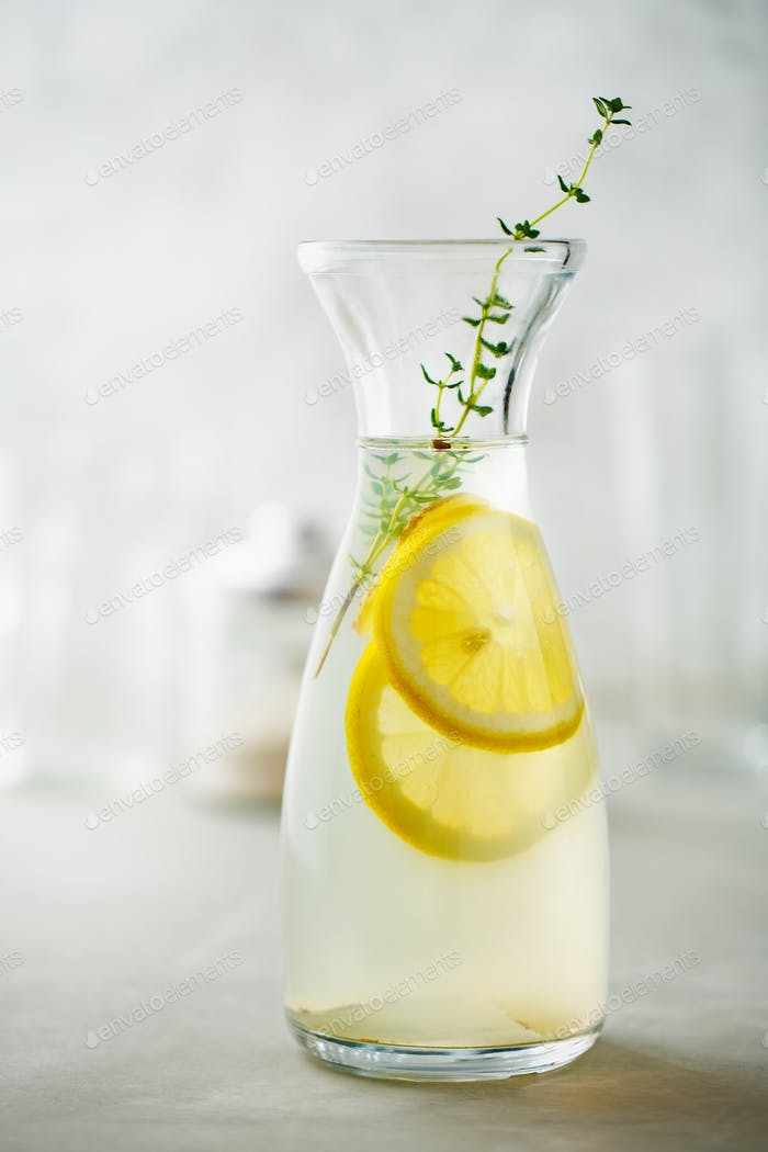Refreshing drink with lemon and thyme
