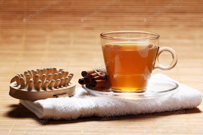 Cup of hot tea on the towel