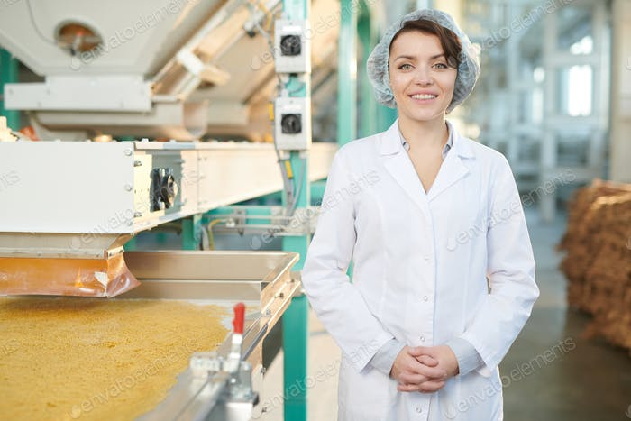 Smiling Woman at Food Factory