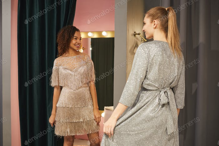 Girlfriends Trying on Gowns in Dressing Room
