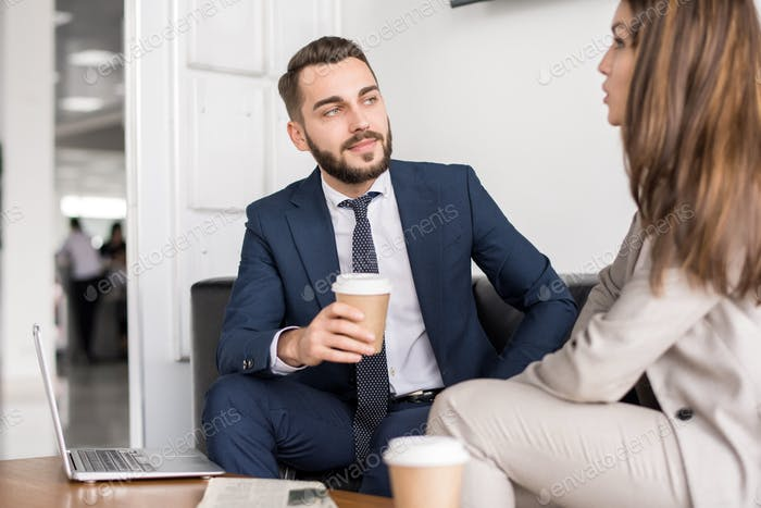 Handsome Businessman Talking to Colleague