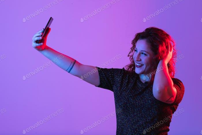 young girl making selfie and having fun