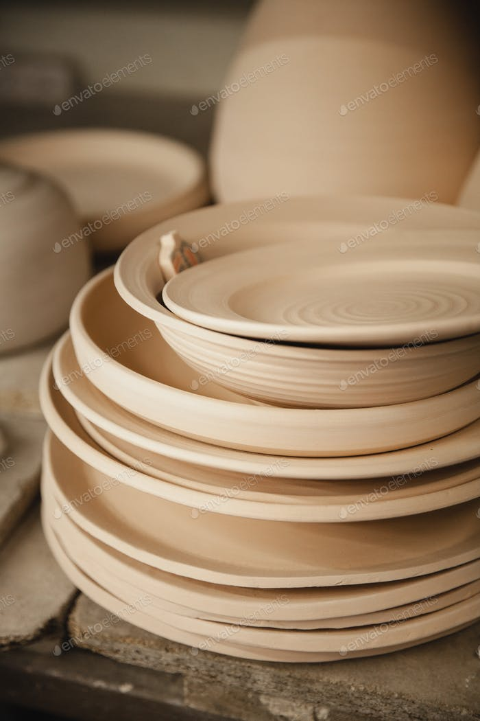 Roasted ceramic plates without glaze closeup