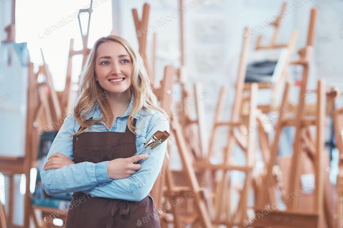 Smiling woman with a brush