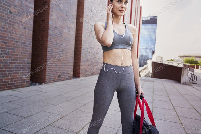 Woman in sports clothes ready for training