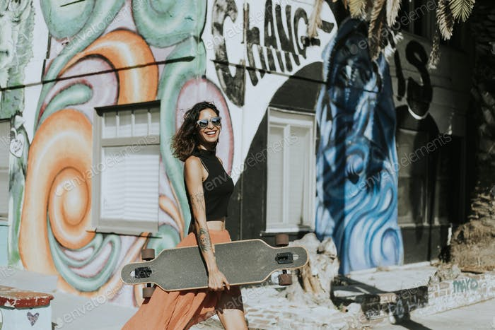 Thumbnail for Cool woman with a longboard