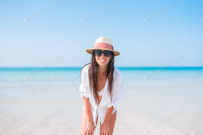 Happy girl background the blue sky and turquoise water in the sea on caribbean island
