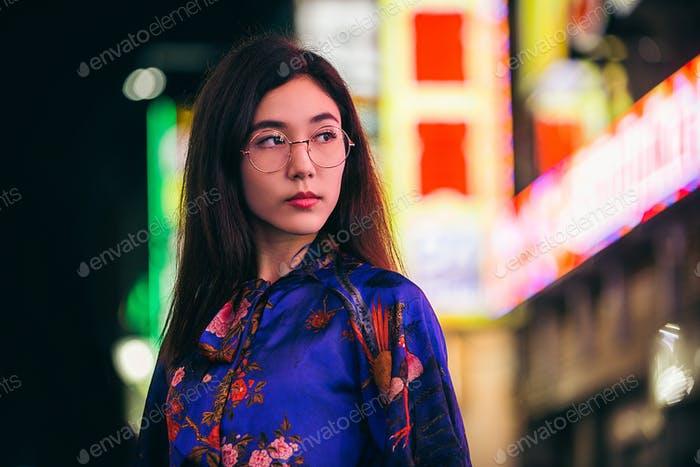 Pretty asian woman portrait with led lights