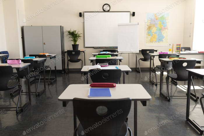 Classroom with desk and whiteboard in school