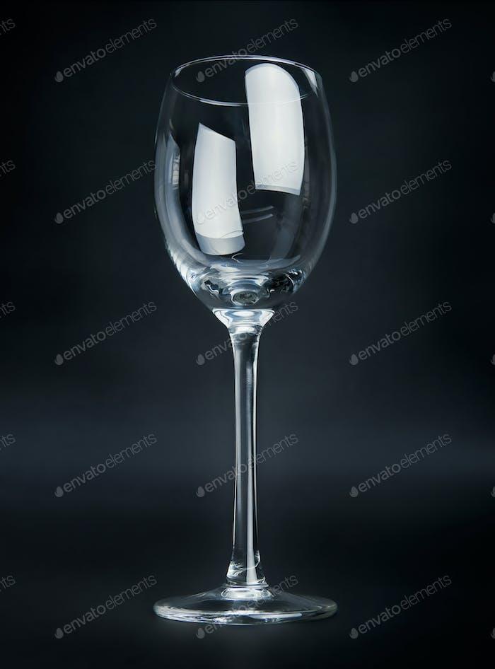 Empty wineglass on black background